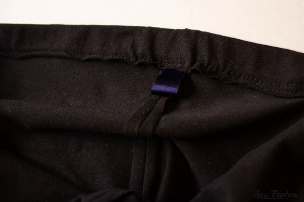 use a bit of satin ribbon to show which side is the back of homemade pants - sewfearless.com