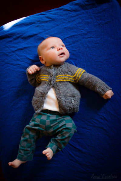 knitted baby sweater, knit pants, swaddle blanket